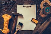 Construction Worker Tools Builder Hammer, Saw, Nails, Screwdrivers On A Wooden Background Flat View poster