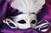 picture of incognito  - A mardi gras masquerade ball mask on a dress made from purple satin - JPG
