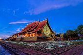 Twilight Shot Of Sirindhorn Wararam Phu Prao Temple Is Public Temple In Ubonrachatani, Thailand. poster