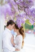 Bridegroom Man And Springtime Woman Hug Each Other In The Park. poster