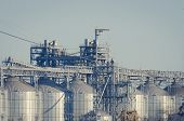 Cylindrical Silos For Grain Storage. Modern Grain Terminal. Elevator. Grain Storage And Processing.  poster