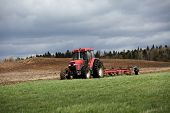Ploughing on a cloudy spring day