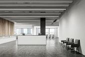 Interior Of Minimalistic Office With White And Wooden Walls, Concrete Floor, White Reception Desk An poster