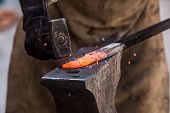 picture of anvil  - Detail shot of metal being worked at a blacksmith forge - JPG
