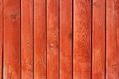 picture of log fence  - Part of vertical ancient wooden fence painted in red - JPG