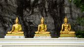 Buddha On Stone Babkground In Cave Of Thailand
