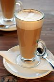 foto of latte  - Latte Coffee with table settings in tall latte glasses - JPG