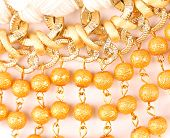 image of macrame  - Golden pearls with macrame close - JPG