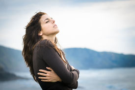 picture of heartbreaking  - Sad woman shivering and feeling the sea breeze - JPG