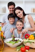foto of family fun  - Smiling family cooking together in the kitchen - JPG