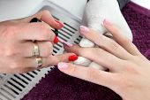 picture of finger-painting  - Finger nail treatment painting with brush and lacquer - JPG