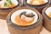 image of siomai  - dim sum in bamboo steamer chinese cuisine - JPG