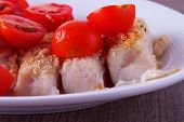 image of hake  - Hake au gratin with tomatoes over white plate - JPG