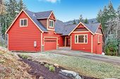 stock photo of red siding  - Red clapboard siding house - JPG
