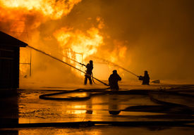 stock photo of firemen  - Firemen at work on fire - JPG