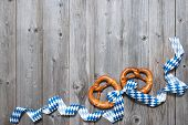 foto of pretzels  - Bavarian pretzels with ribbon on wooden board as a background for Oktoberfest - JPG