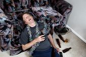 pic of home addition  - Image of mature man falling asleep drunk from home party - JPG