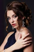 stock photo of opulence  - Luxurious Rich Lady with Stylish Earrings with Jewels - JPG