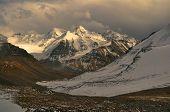stock photo of karakoram  - Scenic view of cloudy Wakhan valley in Tajikistan with snowy mountain peaks of Pamir and Karakoram - JPG