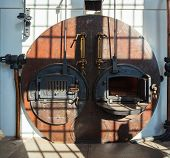 stock photo of blast-furnace  - View of coffee roaster the furnace of old Italian industry in Trieste - JPG