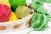image of knitting  - Baby knitting socks on a white wooden background - JPG