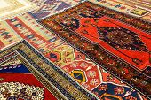 foto of showrooms  - Kayseri Buyun rugs in a carpet showroom in Cappadocia Turkey [[** Note: Shallow depth of field ** Note: Visible grain at 100%, best at smaller sizes - JPG