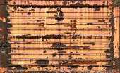 picture of boxcar  - Rusted metal door on old railroad train boxcar - JPG