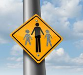 foto of child missing  - Child custody loss concept as a traffic sign with a father and two of his missing children as a family law symbol of social issues caused by divorce and separation - JPG