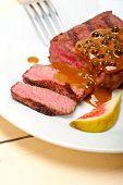 stock photo of ou  - beef filet mignon with green peppercorn creamy sauce ou poivre vert - JPG