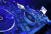 stock photo of track field  - Dj mixes the track in the nightclub at party