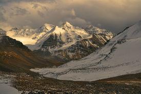 pic of karakoram  - Scenic view of cloudy Wakhan valley in Tajikistan with snowy mountain peaks of Pamir and Karakoram - JPG