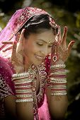pic of indian beautiful people  - Young beautiful Hindu Indian bride in traditional gown outdoors in garden - JPG