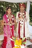 image of indian wedding  - Young Hindu Indian couple wearing traditional wedding clothes on wedding day - JPG