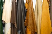 stock photo of raw materials  - Leather pelt fashion color raw material hanging - JPG