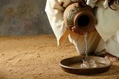 foto of scriptures  - Jesus pouring water from a jar before the feet washing - JPG