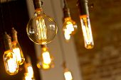 image of decorative  - Decorative antique edison style light bulbs against brick wall background - JPG