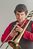 picture of trombone  - Trombone musician takes a moment to be angry at his audience - JPG
