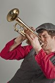 picture of newsboy  - Horn player nails a solo on his old trumpet - JPG