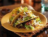 picture of tacos  - plate of tacos with yellow hard shells and beef - JPG