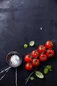 pic of basil leaves  - Cherry tomatoes and green basil leaves on dark marble background - JPG