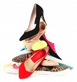 image of piles  - Pile of various female shoes isolated on white - JPG