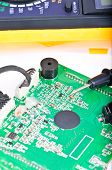 stock photo of  multimeter  - The probe of the digital multimeter on the electronic Board shallow depth of field - JPG