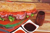 image of french curves  - french sandwich on red plate  - JPG