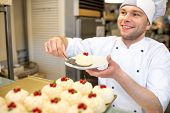 image of confectioners  - Handsome confectioner selling cakes in the pastry shop - JPG