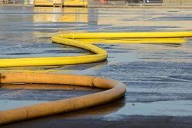 stock photo of firefighter  - Firefighters on using large volume appliance water delivery - JPG
