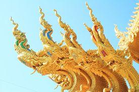 picture of apex  - gold gable apex of public thai temple - JPG