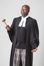 picture of toga  - african american bald men wearing a lawyer toga with questionning expression - JPG