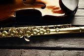 stock photo of flute  - Flute with violin on table close up - JPG