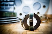 pic of mm  - 35 mm cinema movie filmstrip with picture start frame and other movie objects background - JPG