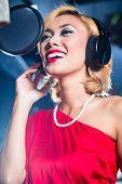 stock photo of recording studio  - Asian professional musician recording new song or album CD in studio - JPG